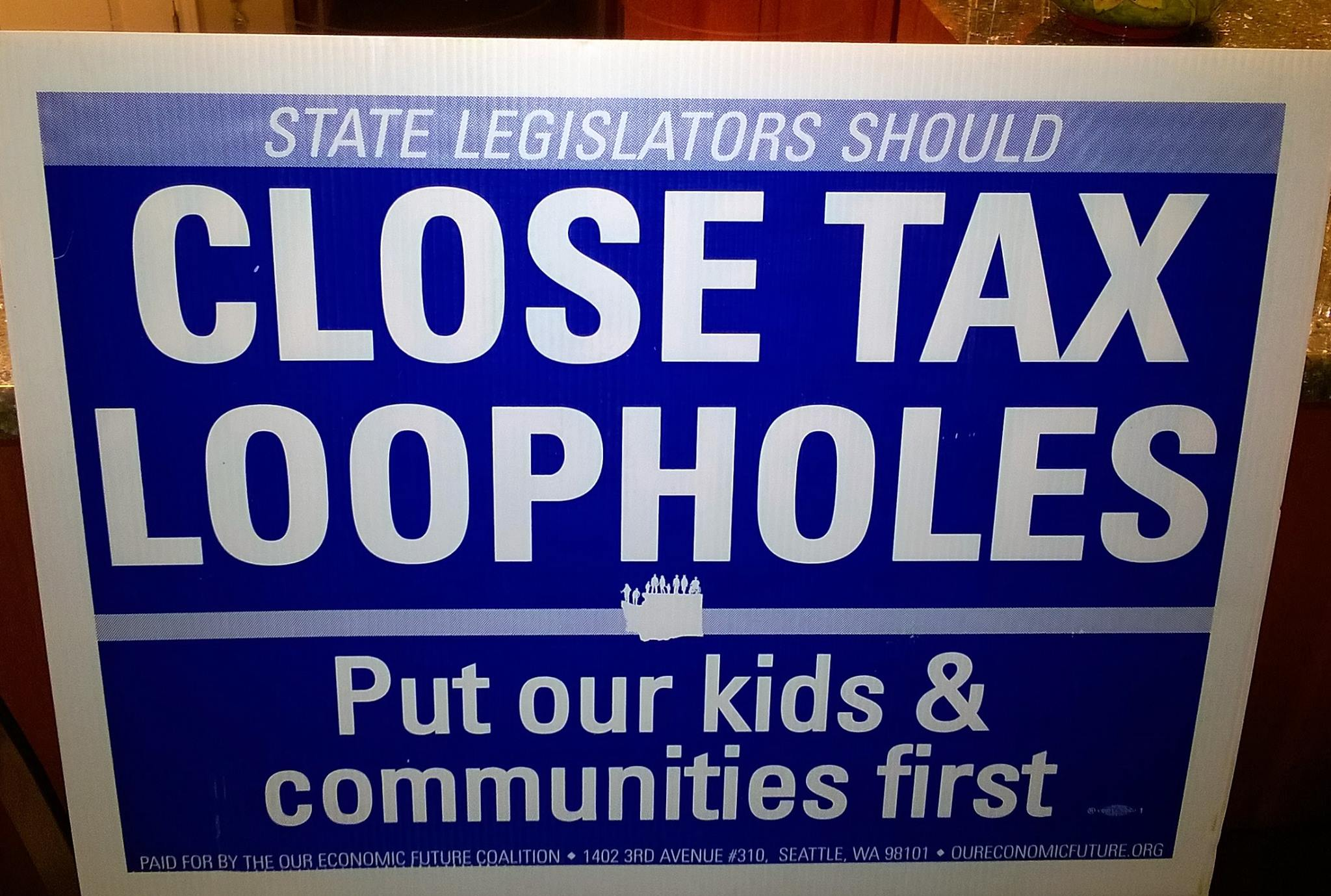 close tax loopholes yardsign